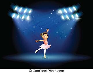 A little girl dancing ballet with spotlights