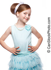 7eb581c36027 A little girl in a blue dress, with a retro hairstyle and accessories.