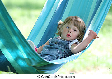 little girl in a hammock