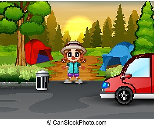 A little girl in the campsite