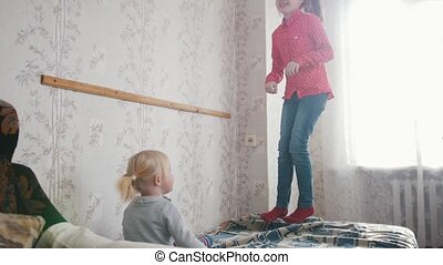 A little girl jumping on the bed