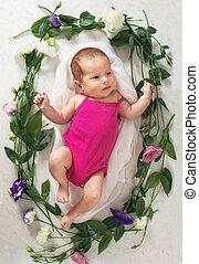 girl lies in a wreath