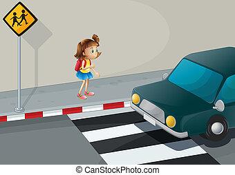 A little girl near the pedestrian lane