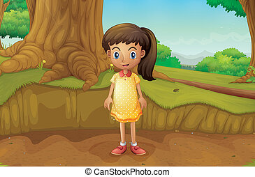 A little girl near the roots of a giant tree