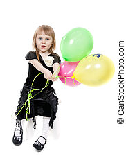 A little girl of four years of age with balloons. Isolate on white