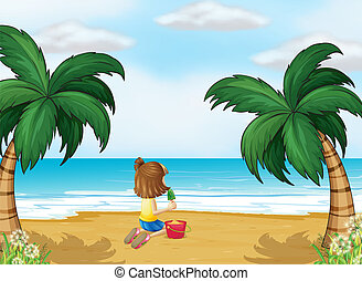 A little girl playing at the beach alone