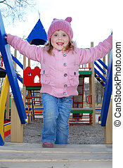 a little girl playing on the playground