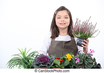 A little girl posing with her plants