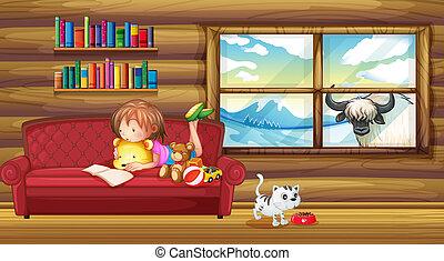 A little girl reading a book