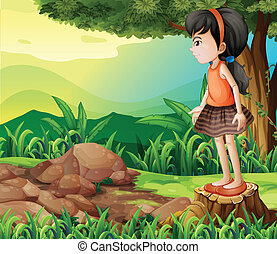 A little girl standing above the stump