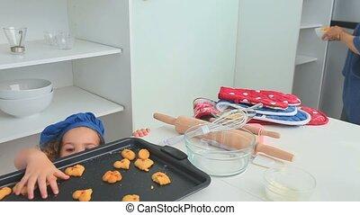 A little girl stealing cookies