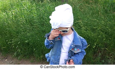 A child is wearing sunglasses