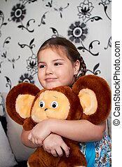 A little girl with a big plush toy.
