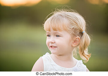 A little girl with a happy relaxed expression