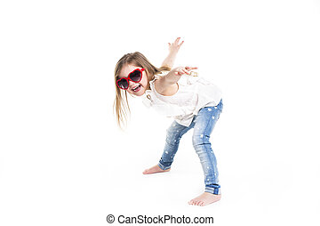 Little girl with love glasses on studio white background