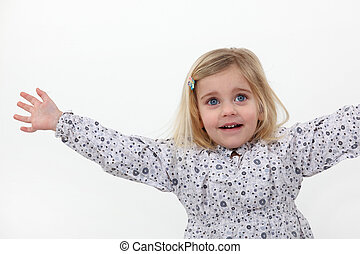 A little girl with stretched arms.