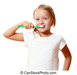 A little kid girl is brushing her teeth with a toothbrush. The concept of daily hygiene. Isolated on white background