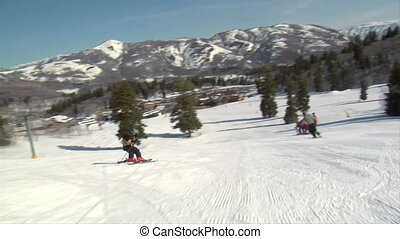 A little kids speeds downhill on skis