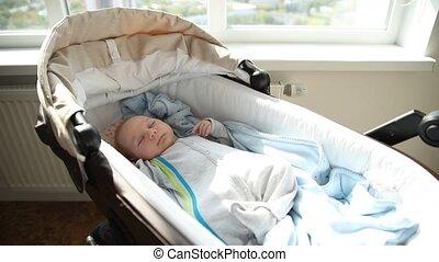 A little newborn baby calmly sleeping in the crib