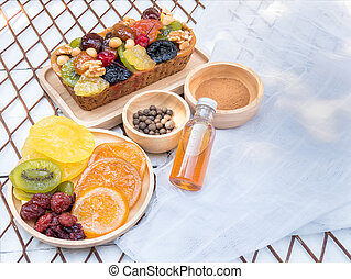 A loaf of fruit cake in wooden plate with dried fruit
