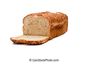 A loaf of whole grain bread on white