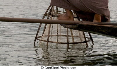 A local checking out his fish basket in the water