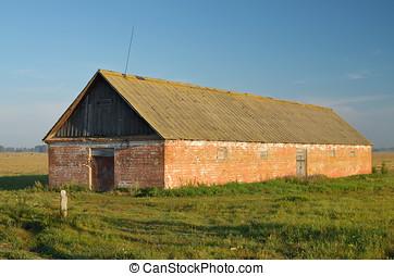 A lone barn in a field.