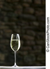 A lone glass of white wine.