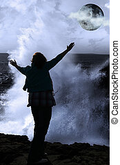 a lone woman raising her arms in awe at the powerful wave...