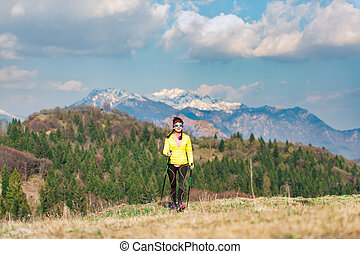 A lonely girl during a trek in the mountains in spring