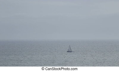 A lonely sailboat in the waters of Atlantic Ocean. Portuagal...