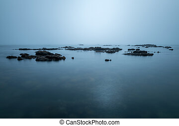 A long exposure seascape with a misty sea