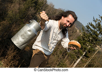 a long-haired grower offering a milk churn and bread