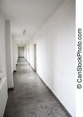 A long hallway in an old high school