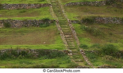 A long stairs leading to the top of a hill