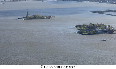 Long view of the Statue of Liberty off Manhattan