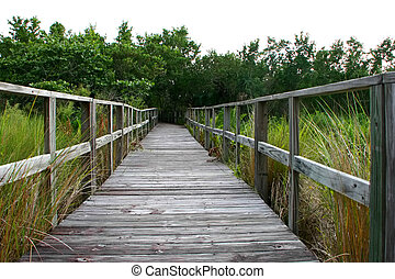 a long wooden boardwalk bridge Sanibel Florida