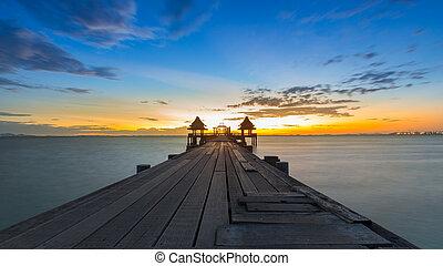 A long wooden pier