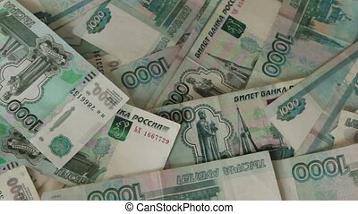 a lot of banknotes Russian rubles lying on the floor