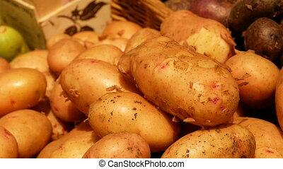 A lot of big potato close-up at the counter