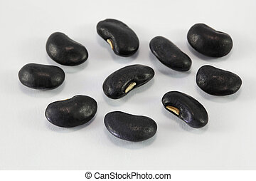 a lot of black bean on white background