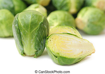 a lot of brussels sprouts on white