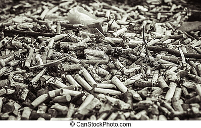 a lot of burnt cigarette butts, close up monochrome view