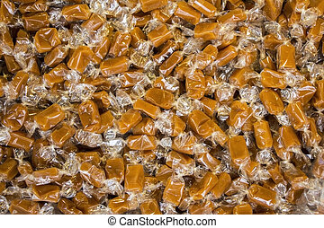 A lot of Caramel candies Wrapped in cellophane