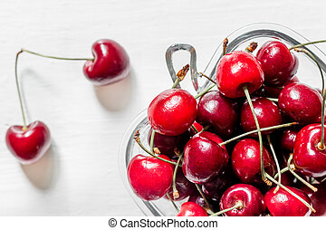 A lot of cherry in bowl on white background