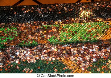 A lot of coins in fountain water. Beautiful colorful background. USA. Las Vegas