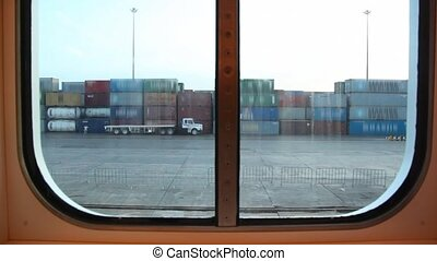 a lot of containers in sea port, view from moving ship...
