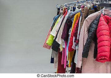 A lot of different clothes on a hanger