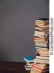 a lot of different educational books on a gray background