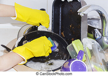 A lot of dirty dishes in a sink waiting to be washed.